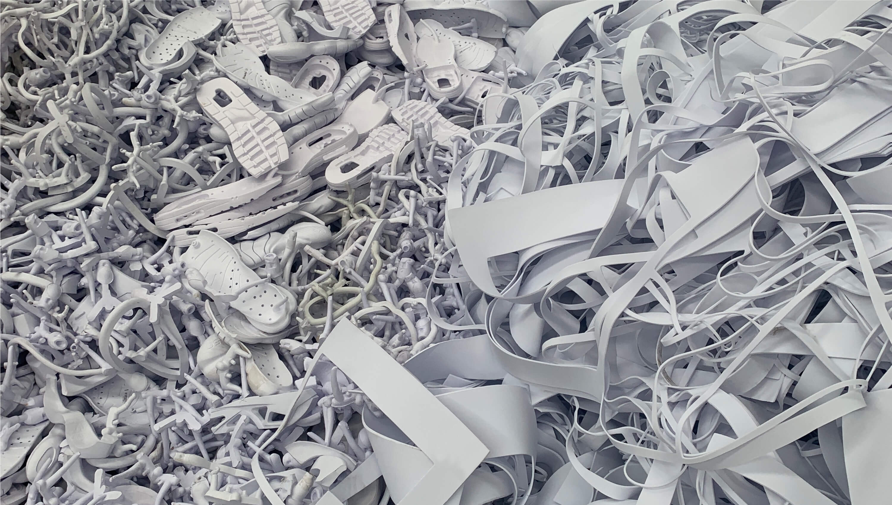 A pile of colorless materials that can be recycled into Nike Grind